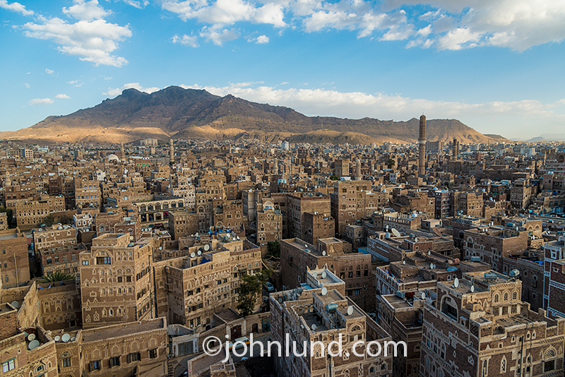 The Old City of Saana, capital of Yemen, is seen at dusk as the street lights begin to add a golden glow to the cobblestone streets.
