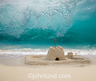 A sand castle is about to be destroyed by a huge ocean wave looming overhead in an image about risk, challenge and change.