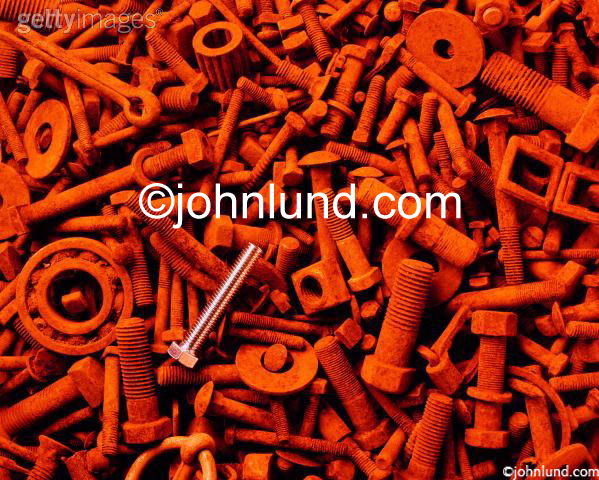 Background Stock Photo of Rusty Old Nuts, Bolts, and Hardware Pieces