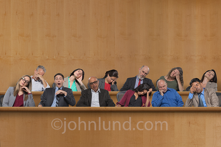 A jury of twelve people are seen in various stages of boredom and sleep in a humorous jury stock photo about effective communications, presentations, and perhaps even issues with our justice system.