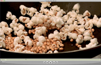 Slow motion video with a Phantom HD camera showing popcorn being popped in a frying pan of hot oil