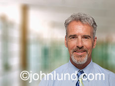 A casual, smiling businessman portrait is a stock image about success and achievement in the business world.