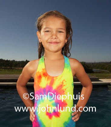 Young pre teen girl with wet hair wearing swim suit Tiny girl teen