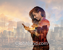 An African American businesswoman is staying connected, in an urban environment, through social media using her smart phone in a stock photo digitally composited image.