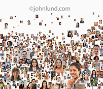 Over a hundred individual portraits combine to create a social media crowd stock photo on a white background in an image about social networking, online community and connections.