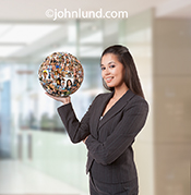 Picture of a woman holding a sphere of people portraits in her hand in a metaphor for having social media