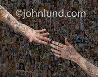 Two hands reach for each other against a background of hundred of people in this photo about out reach and social media.