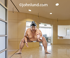 An imposing and menacing Sumo wrestler is ready to rumble in a corporate office lobby in this image about challenge, obstacles and difficulties in the workplace.