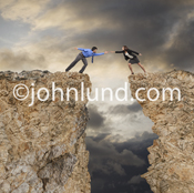 Picture of Two people reaching out to each other over a deep chasm illustrating team work and co-operation.