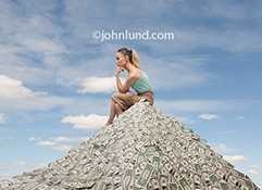 How to make money is on this woman's mind as she sits atop a huge pile of cash.