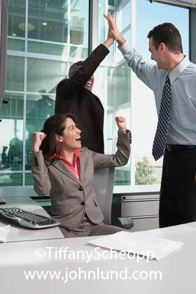 Office Employees Celebrating A Business Success