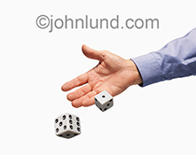 Throwing dice, rolling bones, whatever  you call it, this stock photo of a hand throwing a pair of dice on a white background makes a great image for showing risk, danger, decision making and leadership skills.