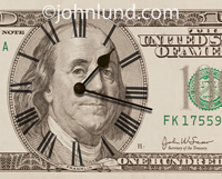 A clock face and hands appear on top of a 100 dollar bill in a concept photo about time and money.