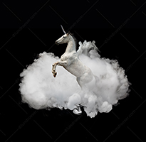 A rearing unicorn rises up through a cloud against a black background in this mythological and mysterious Unicorn stock photo.