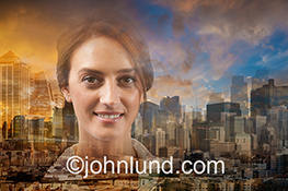 A smiling and confident woman executive is superimposed over a background of big city buildings and a setting sun in this positive and upbeat image about business in the digital age.