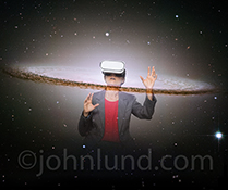 A woman, wearing virtual reality headgear, is shown emerging through the solar system in out space in a stock photo about future technology and virtual reality issues and possibilities.