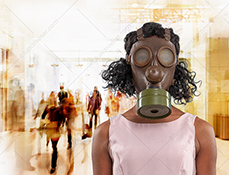 A woman wears a gas mask in front of a busy urban center in a concept stock photo about protection from COVID-19 and other disease and pollution dangers.