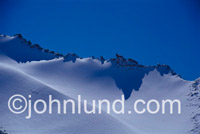 Beautiful scenic picture of a snow-covered Himalayan peak. High in the Himalayan Mountain range a snow-lined ridge lays stark against the thin air at 17,000 feet in altitude.