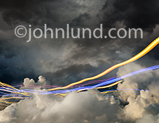 Cloud computing and communications technology are dramatically illustrated in this image of colorful lines of light streaking through clouds in a visual metaphor for streaming data, speed, motion and wireless information transmission.
