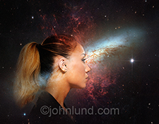 A woman is double exposed over outer space and distant galaxys in a stock photo about mystery, discovery, and even spirituality.