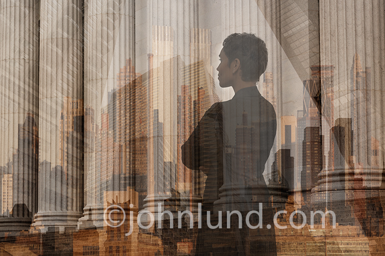 A woman is double-exposed over a multi-exposure of city skylines and high rise buildings in an image that speaks of executive decisions, powerful women, and goals and ambition.