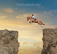A woman jumps a horse from one cliff to another in a stunning display of confidence, skill and daring.