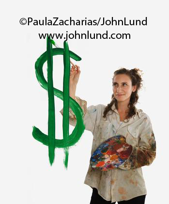 A Hispanic female artist is painting a US dollar sign in the air.  She is very messy, in a paint smeared frock with her palet in one hand and the paint brush in the other. Shoulder length brown hair dishevled. Bad hair day.  Dollar sign is green and big
