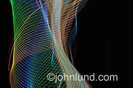 A series of intricate and colorful light patterns take on the shape of a woman's torso in an image that can refer to the human body, auras, energy and wholistic healing.
