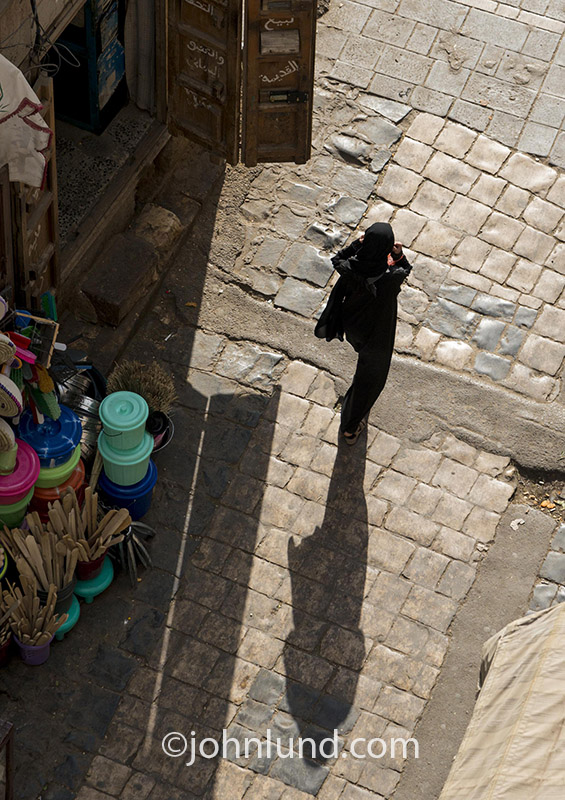 In the Old City of Saana, capital of Yemen, women wear the Muslim