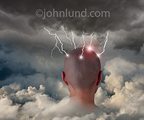 A person' shaved head emerges from a cloudbank and is struck by multiple lighting strikes in a stock photo about brainstorming, ideas, and creativity in the cloud.