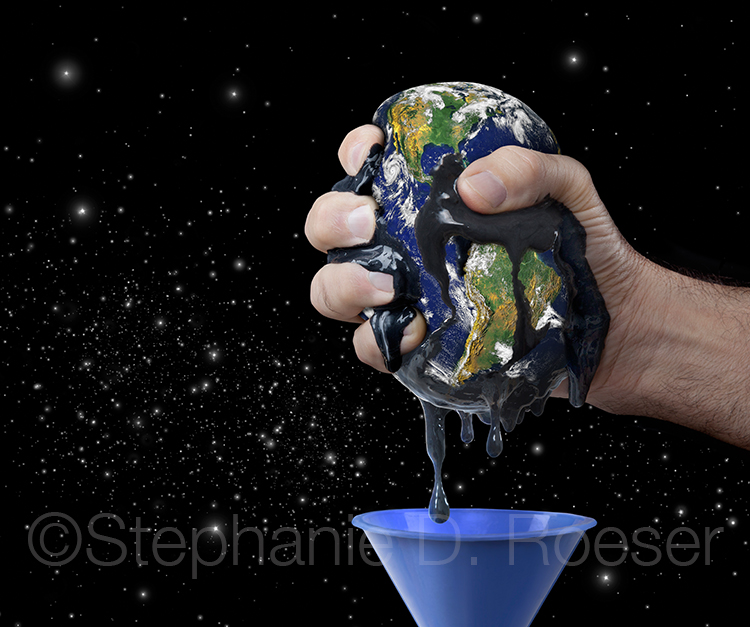 Hand is squeezing oil out of the earth in an image about natural resources, conservation and environmental issues.