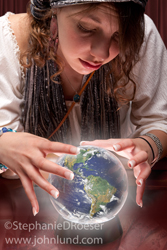 A Gypsy fortune teller peers into her crystal ball in this photo and sees the future of our planet earth.