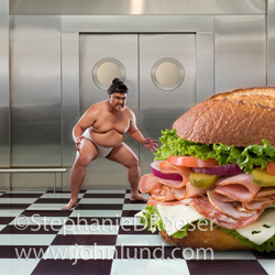 Photo of a Sumo Wrestler about to take on a Giant sub sandwich in a kitchen setting in a humorous look at eating disorders and issues.