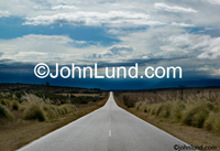 An Argentinian road stretches into the distance in an illustration of stock photo concepts such as the way forward and the future.