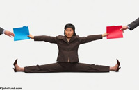 An Asian business woman does the splits while handing folders in two directions in this business concept stock photo