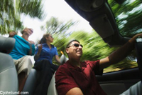 Photos of friends driving a convertible car along a country road with speed and motion blur