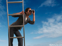 Concept photo of an hispanic woman perched on a ladder using binoculars to scan the horizon in search of business opportunities.