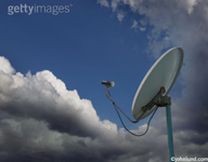 A clear path through clouds leading to a communications antenna. Picture of cloud computing.