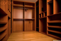 Picture of an upscale, walk-in, empty closet symbolizing scarcity and loss on the one end, and opportunity on the other.