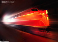 Diesel train locomotive speeding into a tunnel demonstrating speed, motion, energy and transportation.