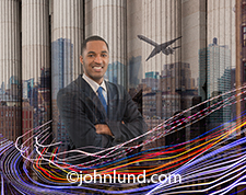 Business connections, particularly in an urban setting, or the primary concept behind this image of an African American business executive montaged into city skylines, a wall street type of building, a commercial jetliner, and streaking lights illustratin