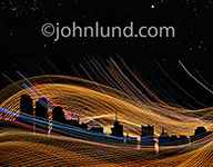 New York City's skyline is silhouetted against a network of streaking lines of light in an image symbolizing communications technology, wireless communications, and cloud computing.