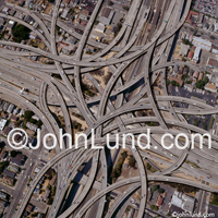 Stock photo of a complex overhead freeway exchange illustrating complexity, connection, networking and transportation. Picture of freeway interchange.
