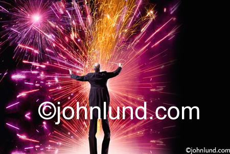 A conductor orchestrates a brilliant, dynamic and colorful fireworks display in a stock photo about creativity, vitality and leadership.