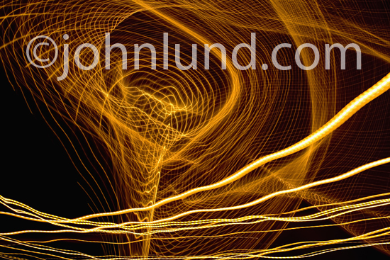 A vortex of energy, a complicated and complex abstract light pattern, and cyberspace are some of the concepts illustrated by this geometric pattern of light streaks in a photograph.