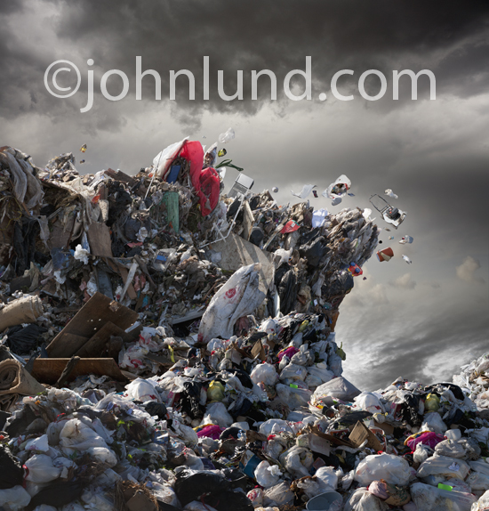A waterless tidal wave of garbage, trash and assorted solid waste looms overhead in an photo designed to call attention to recycling, sustainability and ecological responsibilty