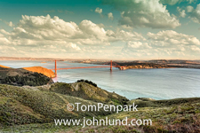 A beautiful panoramic photograph of the Golden Gate Bride and San Francisco and the East Bay beyond shot from the Marin Headlands in HDR.