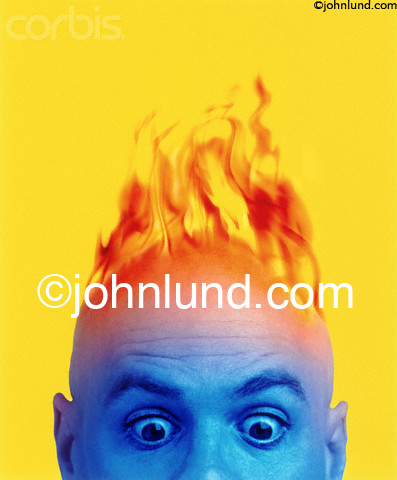 Picture of a man, with his head on fire, looking wide-eyed with downward cast eyes.