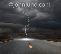 Picture of a lightning bolt striking a long road in an image about challenge, adversity, journeys and the way forward.