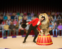 Stock shot of a lion trainer (or tamer) putting his head in a Lion's Mouth representing trust, danger, risk, challenge and, perhaps, foolishness.